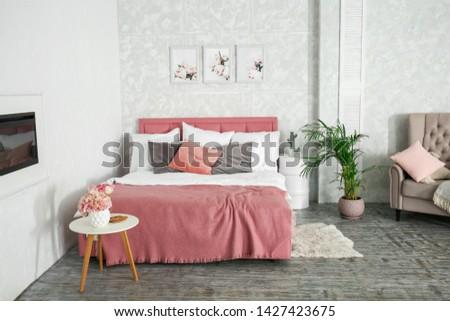 Stylish interior of the bedroom #1427423675