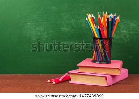 Back to School Concept with Stationery Supplies and Blackboard #1427439869