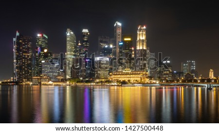Night urban skyline with beautiful lights reflection on water front #1427500448