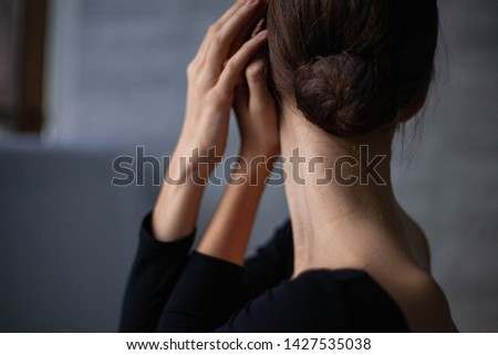 beautiful girl alone with closed face #1427535038