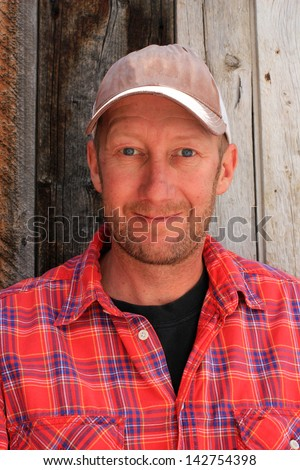 Portrait of a working class man. Royalty-Free Stock Photo #142754398