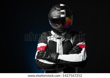 Biker in protective suit with a helmet #1427567252