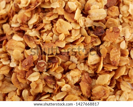 Organic homemade Granola Cereal with oats and almond. Texture oatmeal granola or muesli as background. Food concept. Healthy and wholesome food. #1427668817