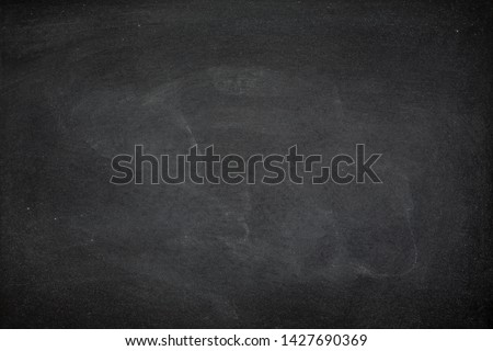 Abstract Chalk rubbed out on blackboard or chalkboard texture. clean school board for background or copy space for add text message. Backdrop of Education concepts. #1427690369