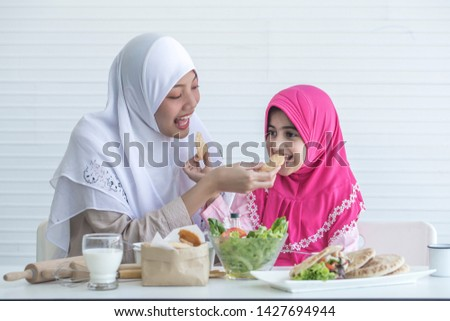 Muslin family Muslin Mon and daughter cooking cuisine , make salad and taste.Delicious breakfast in the kitchen at home.  #1427694944