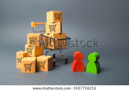 Shopping cart with cardboard boxes with a pattern of trading carts a buyer and seller, manufacturer and retailer. Business and commerce. Negotiations on supply of goods, purchase of goods and services #1427726216