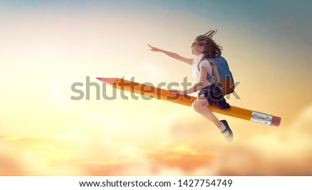 Back to school! Happy cute industrious child flying on the pencil on background of sunset sky. Concept of education and reading. The development of the imagination. #1427754749