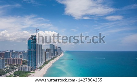 Sunny Isles Beach, Florida/USA - June 18, 2019: Aerial view, drone photography of Sunny Isles Beach City located in northeast Miami-Dade County, Florida in beautiful sunny day #1427804255