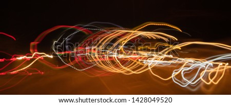 Beautiful blurred images of car lights with different characteristics that run on highway roads at night with speed. Long exposure photography techniques.