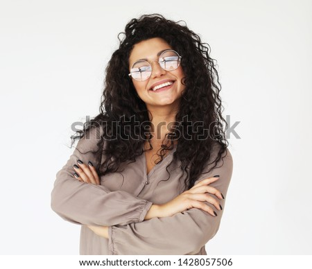 lifestyle and people concept - young smiling african woman wearing eyeglasses and casual clothes over white background #1428057506