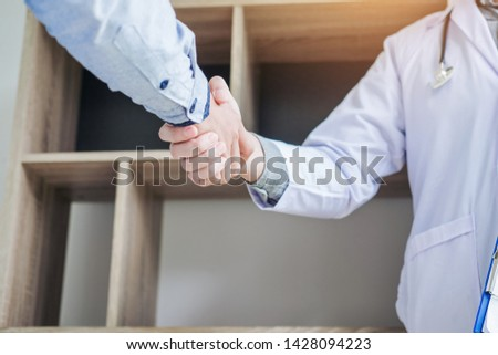 Confident Doctor shaking hands with patients talk in the hospital #1428094223