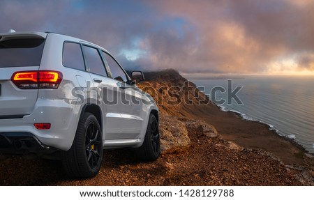 SUV driving on mountain off-roads #1428129788