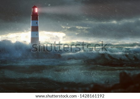 Glowing Lighthouse during heavy storm  Royalty-Free Stock Photo #1428161192