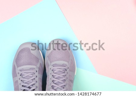 Grey sneakers on multicolored pastel background. Concept of healthy life, everyday training and force of will. #1428174677
