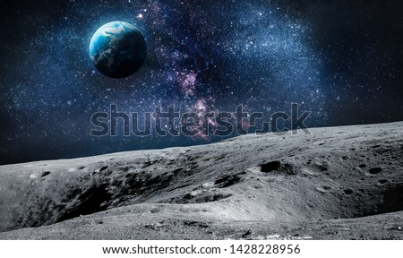 Surface of Moon. Planet Earth on background. Space collage. Elements of this image furnished by NASA.