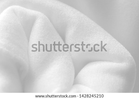 Background with white rolled fleece, soft napped insulating fabric made of polyester #1428245210