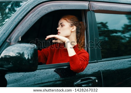 Female driver at the wheel of a car traveling lifestyle nature leisure leisure trip #1428267032