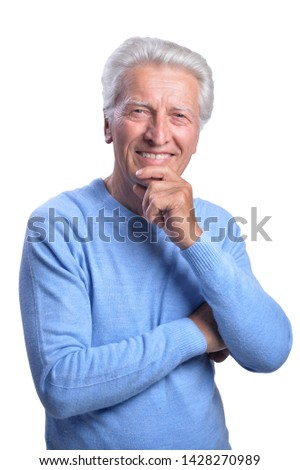 Portrait of smiling senior man on white background #1428270989