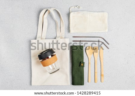 Set of Eco friendly bamboo cutlery, eco bag and reusable coffee mug. Sustainable lifestyle. Plastic free concept. #1428289415