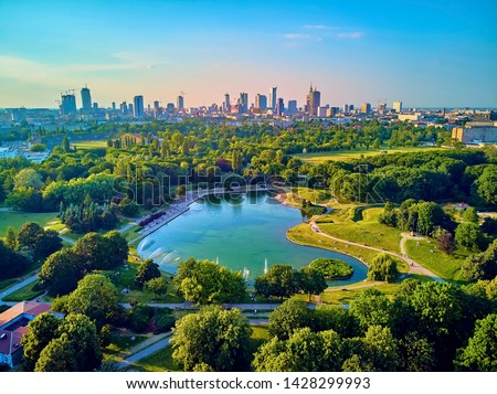 "A beautiful panoramic view of the sunset in a fabulous evening in June from drone at Pola Mokotowskie in Warsaw, Poland - ""Mokotow Field"" is a large park in Warsaw - Is called ""Jozef Pilsudski Park"" #1428299993"
