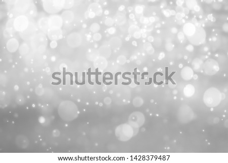 gray bokeh White and Silver lights on bokeh abstract background. #1428379487