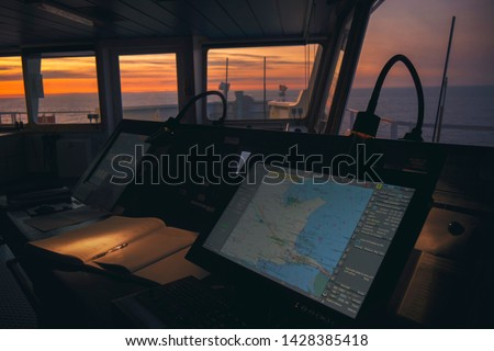 wheelhouse in modern ship with ECDIS and Bridge Log book #1428385418