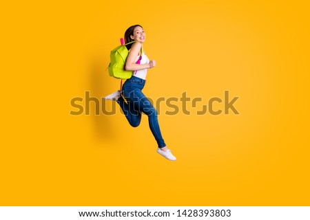 Full length body size view photo of lovely funny funky she her lady youth speed run runner high-school have bag feel excited content isolated dressed fashionable sneakers singlet colorful background