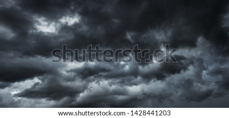 Before heavy rain storm. On the sky is covered all over by the clouds. A lot of lightning and strong wind. The dark clouds is look like  a big  black smoke from  erupting volcano #1428441203