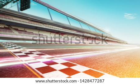 Wide angle view empty asphalt international race track with start and finish line , speed lighting and motion blur effect apply . #1428477287