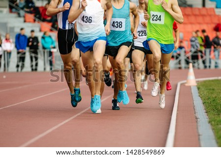 group of athletes runners middle distance running of competition in athletics #1428549869