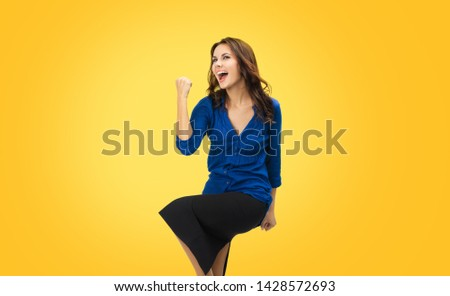Yes, I done it! Very happy gesturing young business woman. Excited girl with open mouth in blue confident clothing, isolated over yellow orange background. Brunette model at studio picture.