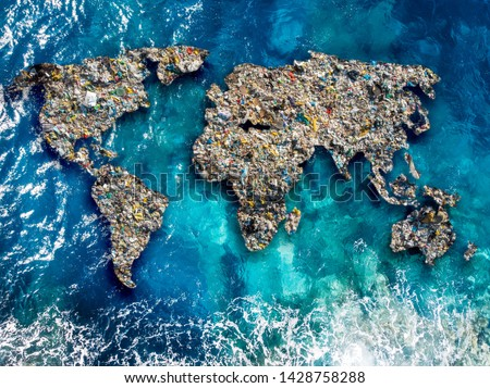 Continents earth are made up of garbage, surrounded by ocean water. Concept environmental pollution with plastic and human waste. Royalty-Free Stock Photo #1428758288