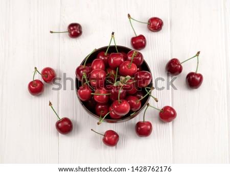 Fresh cherry on plate on wooden white background. fresh ripe cherries. sweet cherries. #1428762176