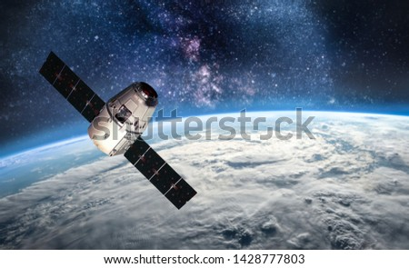 Planet Earth and cargo space ship on orbit. View from ISS. Elements of this image furnished by NASA