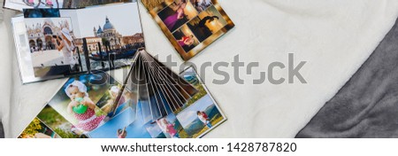 Albums with photos of travel and vintage old camera Royalty-Free Stock Photo #1428787820