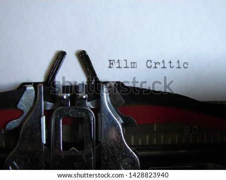 """the words """"film critic"""" typed on a typewriter #1428823940"""