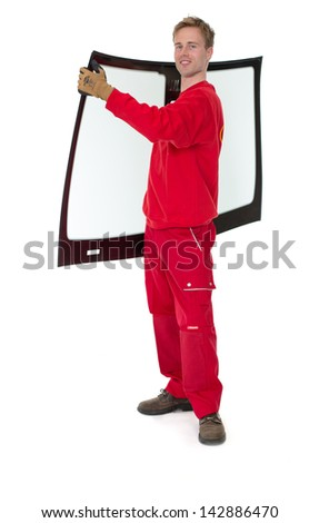 Worker glazier's workshop with car windscreen or windshield isolated in front of white background #142886470