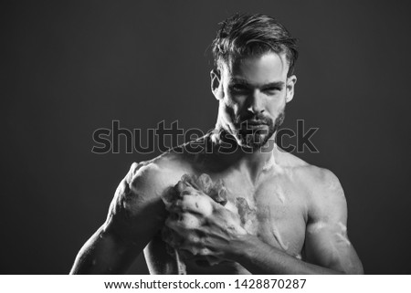 Shower man. Handsome man with beard taking shower. Sexy man taking shower in bathroom. Attractive sportsman with wet muscular body taking shower in bath. Young man washing his body with soap in bath. #1428870287