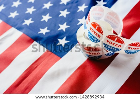 I vote today stickers roll, in US elections on American flag. #1428892934