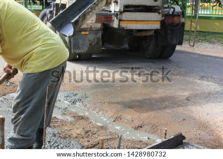 CHAIYAPHUM, THAILAND, June, 2019. A concrete floor is under construction. There's a cement truck and some workers are working in the area. #1428980732