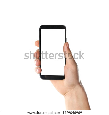 Man holding smartphone with blank screen on white background, closeup of hand. Space for text #1429046969