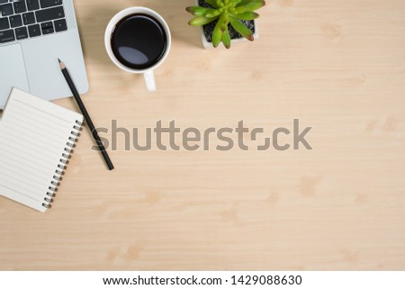 Flay lay, Top view office table desk with computer laptop, notepad, coffee, pencil, leaves with copy space wood background. #1429088630