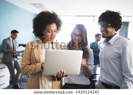 Programmers cooperating at IT company developing apps #1429124345