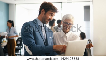 Successful business group of people at work in office #1429125668