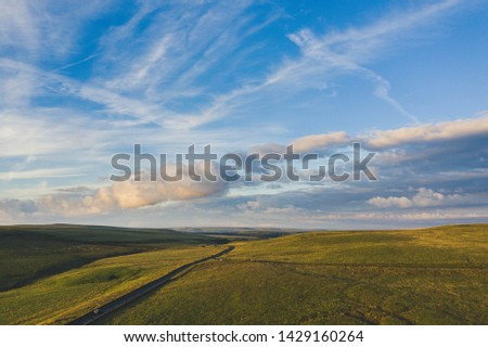 An aerial view of English countryside fields at sunset #1429160264