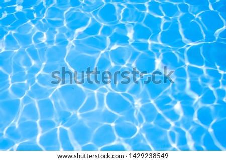 Ripple water in swimming pool sun reflection #1429238549