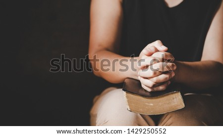 Christian life crisis prayer to god. Woman Pray for god blessing to wishing have a better life. woman hands praying to god with the bible. begging for forgiveness and believe in goodness.  #1429250552