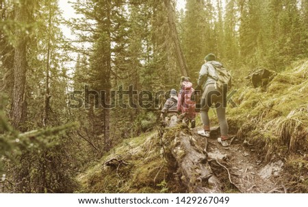 mother with sons climbing in Western Sayan mountains, Siberia #1429267049