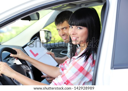 Beautiful young woman  taking driving lesson #142928989
