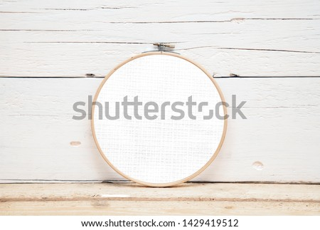 hoops for embroidery on a wooden background - a round layout for embroidery - round hoops for embroidery - a direct view Royalty-Free Stock Photo #1429419512